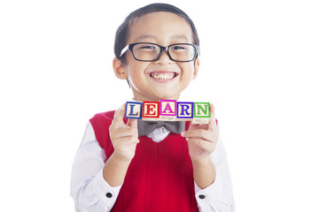 Schoolboy with LEARN word