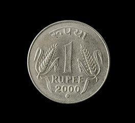 one indian rupee isolated on black background
