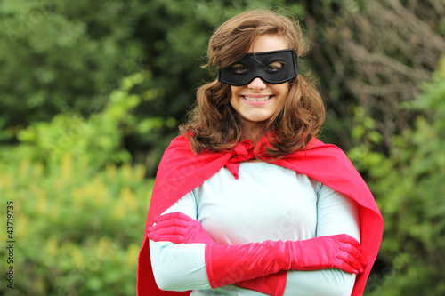 Smiling super hero girl
