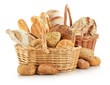 Bread and rolls in wicker baskets isolated on white
