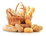 Fototapety Bread and rolls in wicker basket isolated on white
