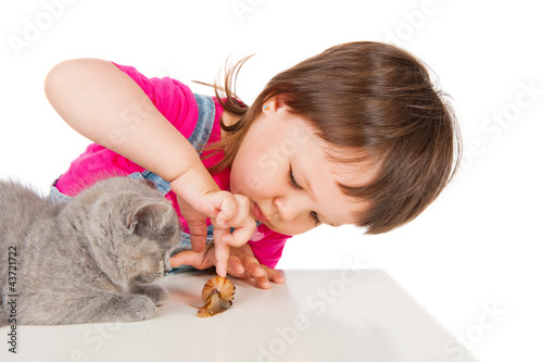 Little girl playing with a kitten and snail