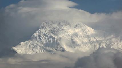Annapurna in cloud. Himalaya Range, Nepal.