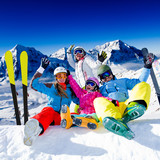 Skiing, winter fun - happy family ski team