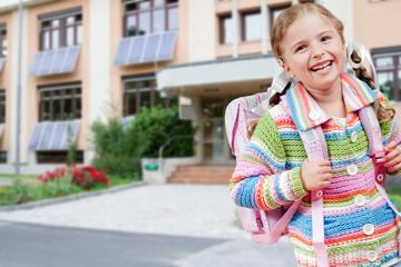 Back to school -  outdoor portrait of lovely  schoolgirl