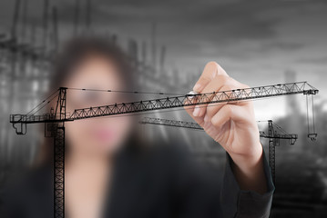 Business Lady drawing Crane line for Construction concept.