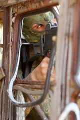 Terrorist in a mask with a gun