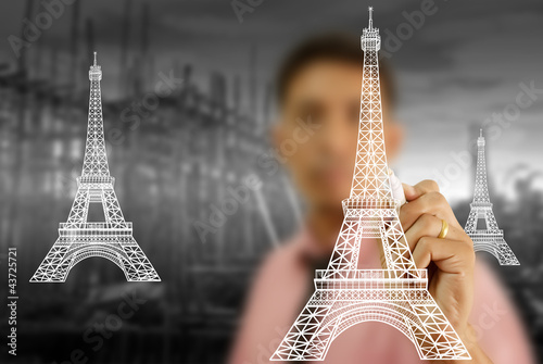 Businessman drawing Eiffel Tower line  in Paris.