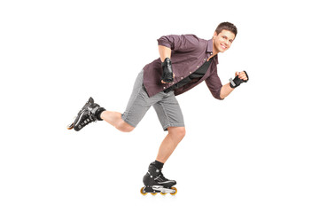 Full length portrait of a handsome man roller skating