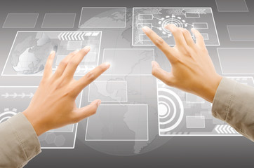 Hand pushing digital button on touch screen interface.