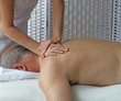 Double handed massage to shoulder