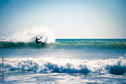 Kite surfing in waves.