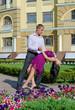 Couple ballroom dancing in a garden