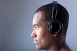 Profile of a beautiful african man listening to music in headpho