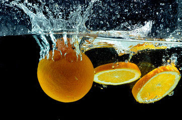 Orange Fruit Splash on water