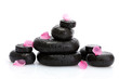 Spa stones with drops and pink petals isolated on white.