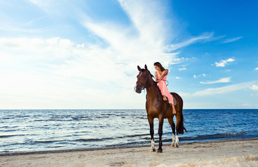 beautiful girl  with horse on seacoast