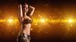 attraktive orientalische Tänzerin vor Lichterhintergrund