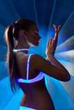 Beauty woman in dance with ultraviolet make-up poster