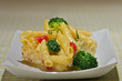 spaghetti with cheese;  broccoli and red pepper.