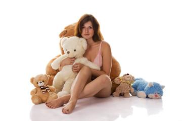 The girl hugging teddy bear