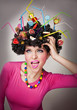 Portrait of a female isolated with lollipops in the hair
