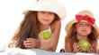 Little girls eating apples