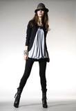 Fototapety full-length fashion model in hat modern dress posing