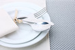 White empty plates with fork, spoon and knife tied with a