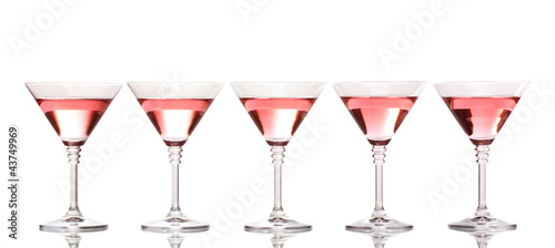 Red cocktail in martini glasses isolated on white