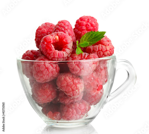 ripe raspberries with mint in glass cup isolated on white