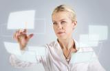 Beautiful woman touching a digital screen, panel, hologram poster