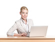 Businesswoman sitting at a office table with laptop