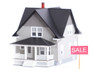 Household architectural model with sale sign, isolated