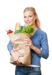 Attractive woman with a paper bag full of healthy food