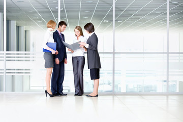 Business people discussing in a office corridor