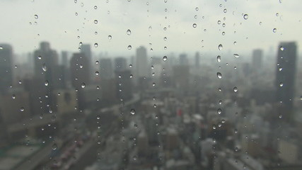 Aerial view of Osaka city during rain storm, Japan