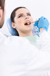 Dentist meticulously examines the oral cavity