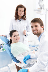 Dentist, assistant and the patient are ready for treating