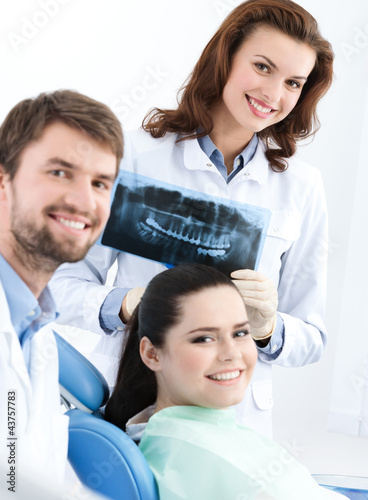 Dentist, assistant and client are satisfied of their work