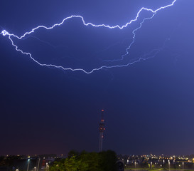Horizontal lightning above telecommunitations tower