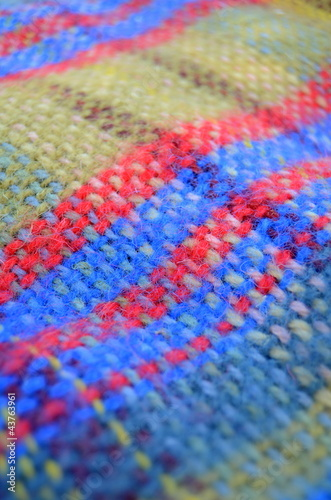 A Woven Woollen Picnic Blanket With Shallow Depth Of Focus
