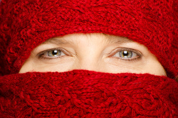 Middle-aged woman wrapped up in red scarf