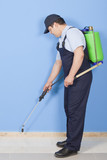 Man spraying insects- pest control  poster