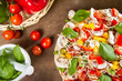Fresh pizza and vegetables