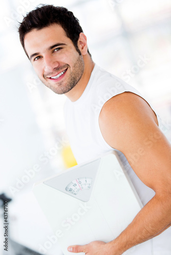 Man holding a weight scale