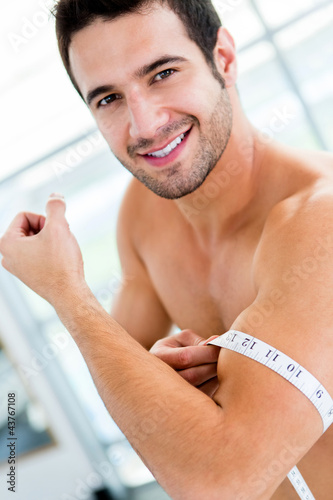 Man measuring his muscles