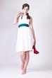 Beautiful young woman posing in white dress