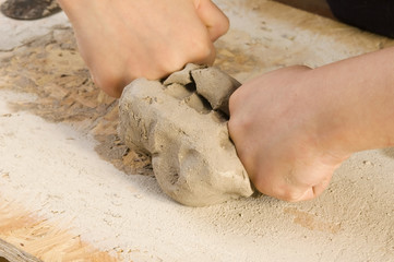 Child hands of a potter