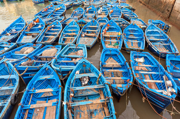 Empty blue colored fishing boats in harbor